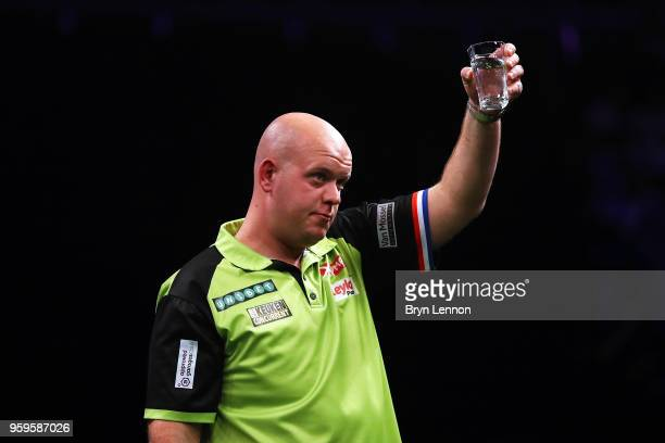 Michael van Gerwen of The Netherlands celebrates beating Rob Cross of Great Britain in their semifinal at the Betway Premier League Darts PlayOffs at...