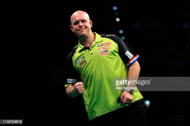 Michael van Gerwen of the Netherlands celebrates during his match against James Wade of England during the 2019 Unibet Premier League Darts at Arena...