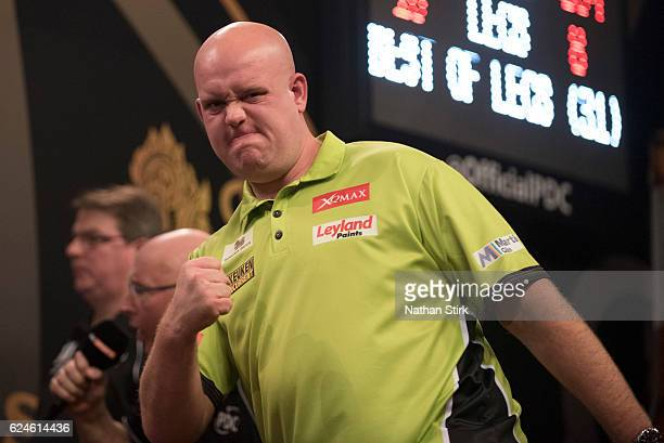 Michael van Gerwen of the Netherlands celebrates during his semifinal match against Peter Wright of Scotland during the SINGHA Beer Grand Slam of...
