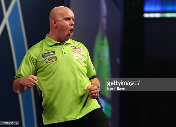 Michael van Gerwen of the Netherlands celebrates during his third round match against Gerwyn Price of Wales on day eleven of the 2018 William Hill...