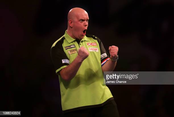 Michael van Gerwen of the Netherlands celebrates during the 2019 William Hill World Darts Championship SemiFinal match between Michael van Gerwen and...