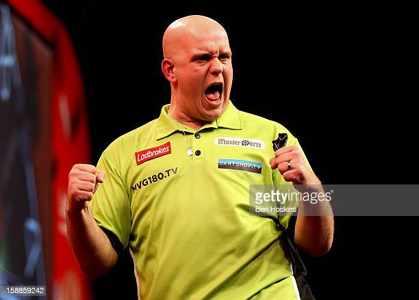 Michael van Gerwen of the Netherlands celebrates during the final of the 2013 Ladbrokescom World Darts Championship at the Alexandra Palace on...