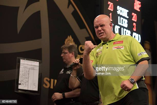 Michael van Gerwen of the Netherlands celebrates during the final match against James Wade of England during the SINGHA Beer Grand Slam of Darts at...