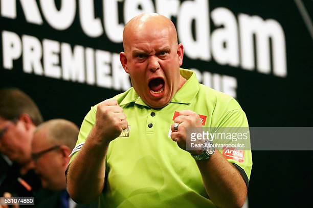 Michael van Gerwen of the Netherlands celebrates victory in his match against Phil 'The Power' Taylor of England during the Darts Betway Premier...
