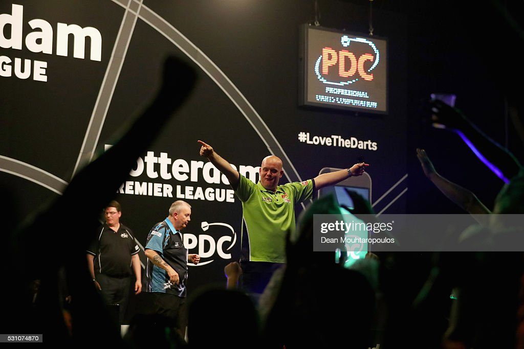 Michael van Gerwen of the Netherlands celebrates victory in his match against Phil 'The Power' Taylor of England during the Darts Betway Premier League Night 15 at Rotterdam Ahoy on May 12, 2016 in Rotterdam, .