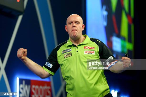 Michael van Gerwen of the Netherlands celebrates victory in the Final match against Michael Smith of England during Day 17 of the 2019 William Hill...