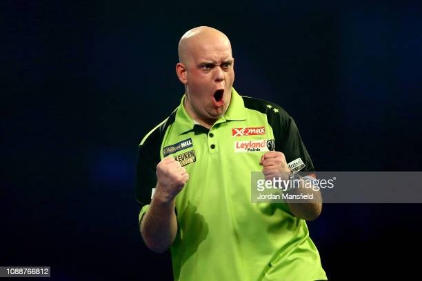 Michael van Gerwen of the Netherlands celebrates winning a set during the Final match against Michael Smith of England during Day 17 of the 2019...