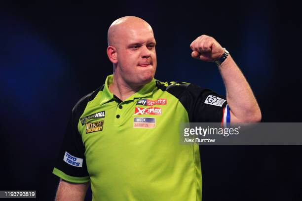 Michael van Gerwen of The Netherlands celebrates winning his Second Round match against Jelle Klaasen of The Netherlands during Day One of the 2020...
