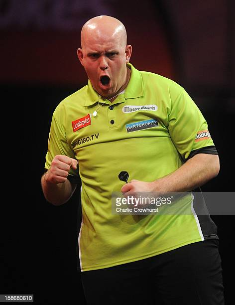 Michael van Gerwen of the Netherlands celebrates winning his second round match against Peter Wright of England on day Ten of the Ladbrokescom World...