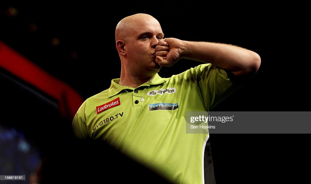 Michael van Gerwen of the Netherlands celebrates winning his semi final match against James Wade of England on day fourteen of the 2013 Ladbrokes.com World Darts Championship at the Alexandra Palace on December 30, 2012 in London, England.