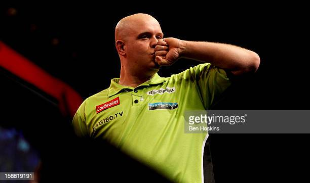 Michael van Gerwen of the Netherlands celebrates winning his semi final match against James Wade of England on day fourteen of the 2013 Ladbrokescom...