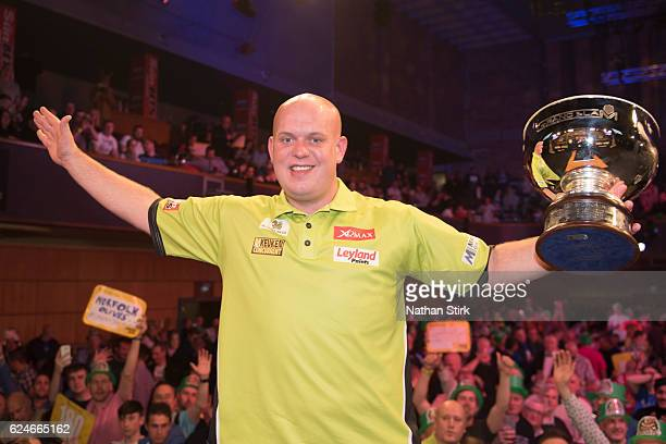 Michael van Gerwen of the Netherlands celebrates winning the SINGHA Beer Grand Slam of Darts against James Wade at Wolverhampton Civic Hall on...