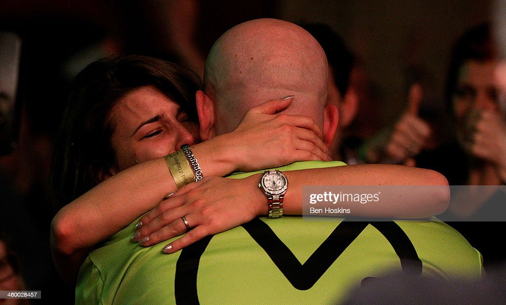 Michael van Gerwen of The Netherlands celebrates with his girlfriend Daphne after winning the final of the Ladbrokes.com World Darts Championships at Alexandra Palace on January 1, 2014 in London, England.