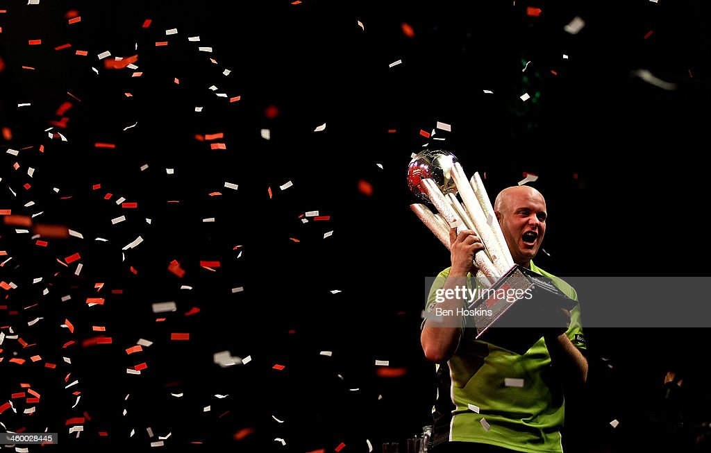 Michael van Gerwen of The Netherlands celebrates with the trophy after winning the final of the Ladbrokes.com World Darts Championships at Alexandra Palace on January 1, 2014 in London, England.