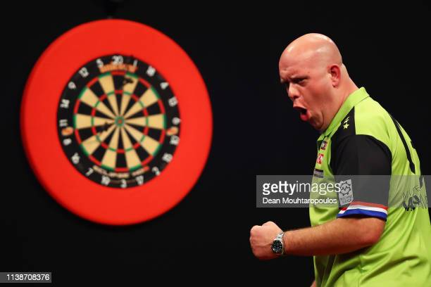 Michael van Gerwen of the Netherlands competes against Peter Wright of Scotland during day one of the 2019 Unibet Premier League Darts on March 27...