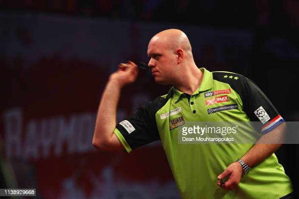 Michael van Gerwen of the Netherlands competes against Raymond van Barneveld of the Netherlands during day two of the 2019 Unibet Premier League...