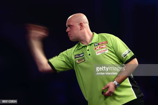 Michael van Gerwen of the Netherlands in action during his first round match against Christian Kist of the Netherlands during day one of the 2018...