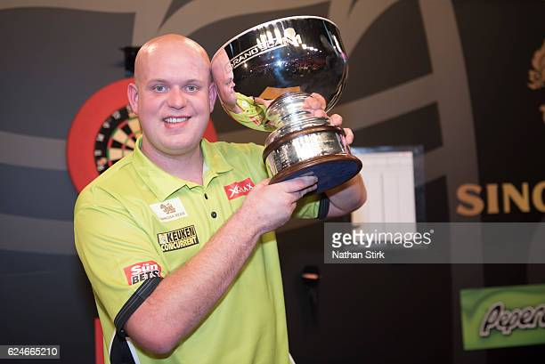 Michael van Gerwen of the Netherlands is awarded the SINGHA Beer Grand Slam of Darts after the game against James Wade at Wolverhampton Civic Hall on...