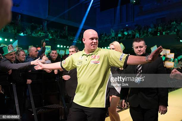 Michael van Gerwen of the Netherlands is greeted by the crowd ahead of his final match against James Wade of England during the SINGHA Beer Grand...