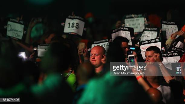 Michael van Gerwen of the Netherlands looks on before he plays his match against Phil 'The Power' Taylor of England during the Darts Betway Premier...