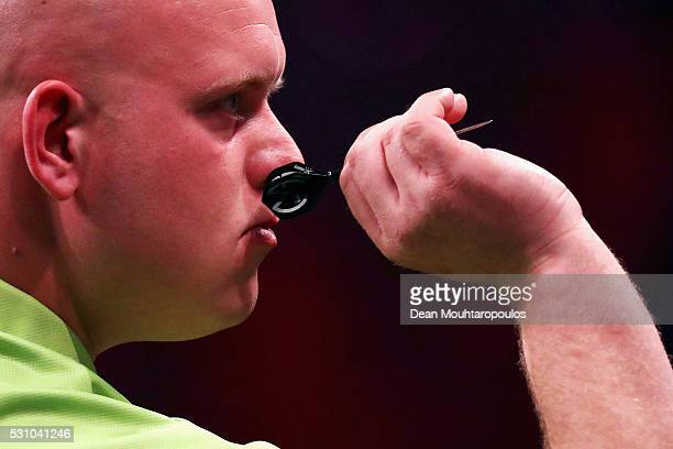 Michael van Gerwen of the Netherlands plays a shot in his match against Phil 'The Power' Taylor of England during the Darts Betway Premier League...