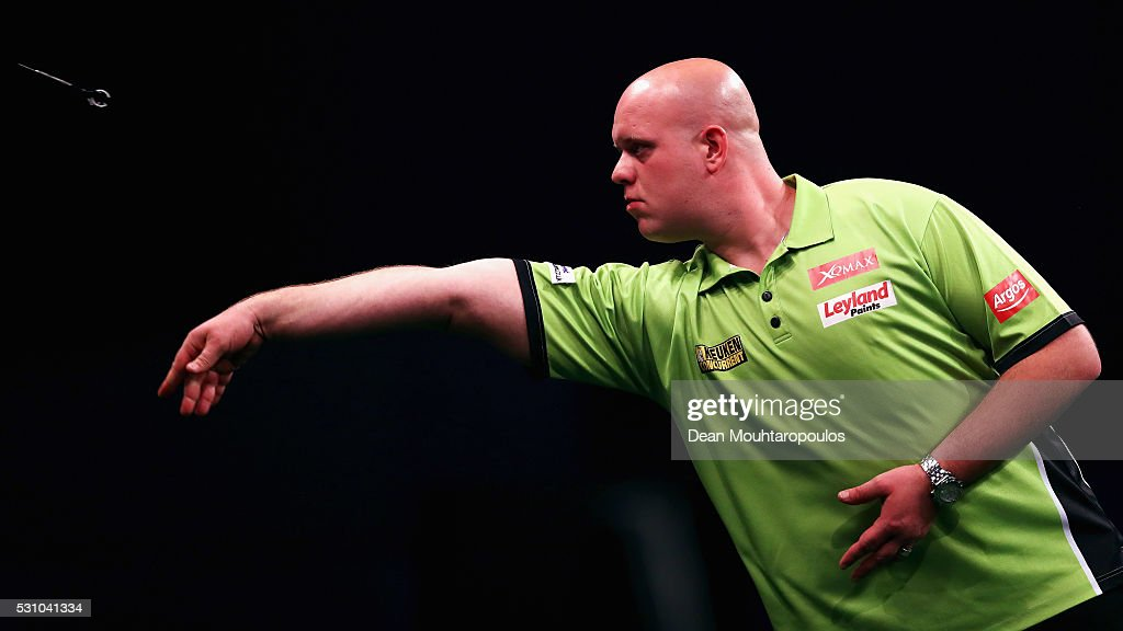 Michael van Gerwen of the Netherlands plays a shot in his match against Phil 'The Power' Taylor of England during the Darts Betway Premier League Night 15 at Rotterdam Ahoy on May 12, 2016 in Rotterdam, .