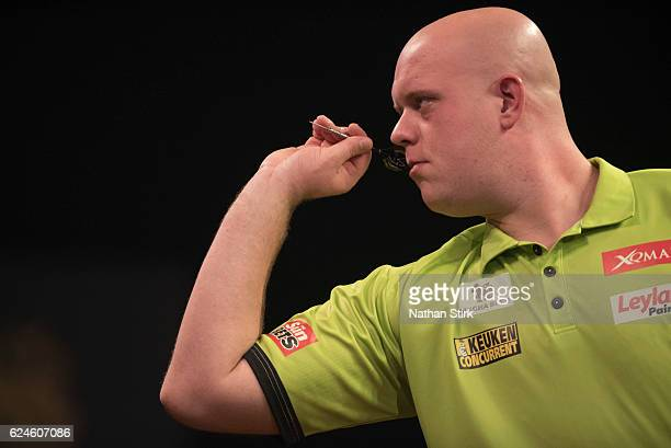 Michael van Gerwen of the Netherlands plays a shot in his semifinal match against Peter Wright of Scotland during the SINGHA Beer Grand Slam of Darts...