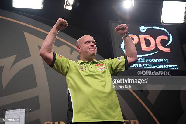 Michael van Gerwen of the Netherlands plays a shot in the final match against James Wade of England during the SINGHA Beer Grand Slam of Darts at...