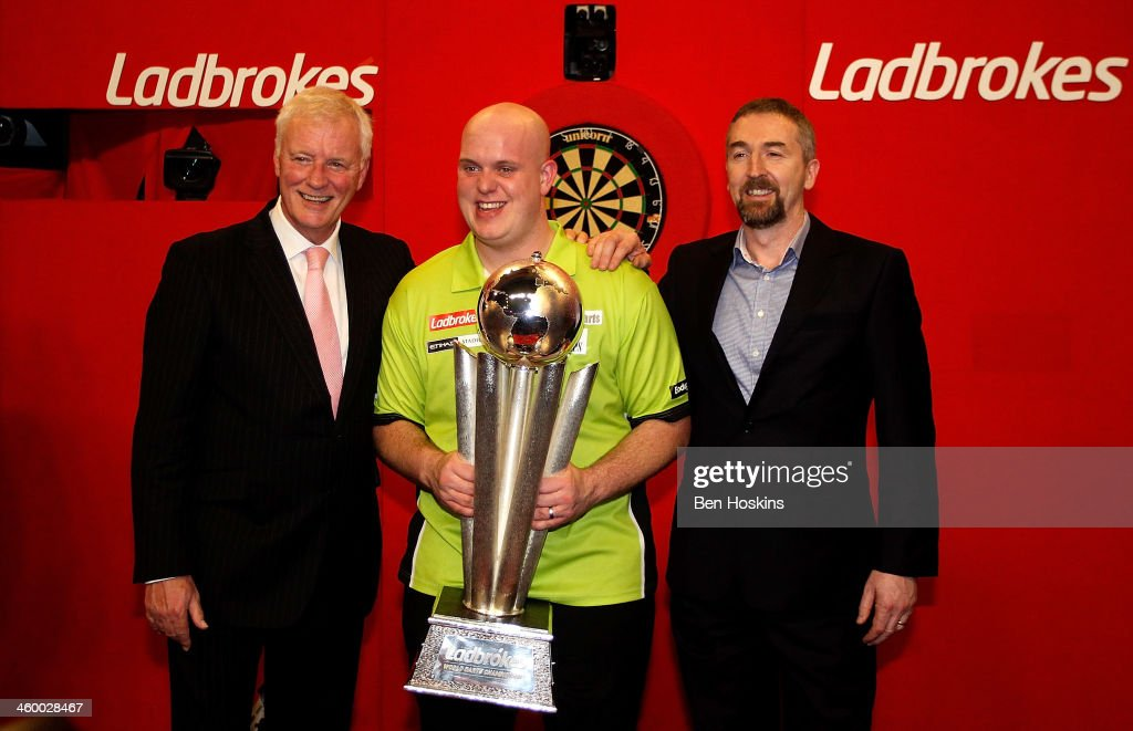 Michael van Gerwen of The Netherlands (C) poses for a picture with the Chairman of the PDC Barry Hearn (L) and the Cheif Executive of Ladbrokes Richard Glynn (R) after winning the final of the Ladbrokes.com World Darts Championships at Alexandra Palace on January 1, 2014 in London, England.