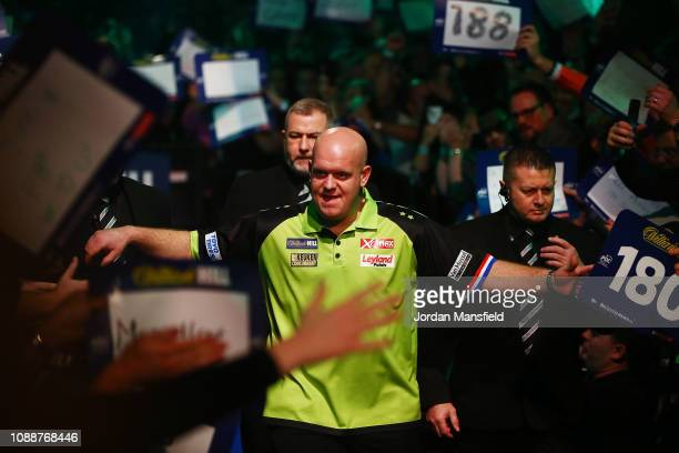Michael van Gerwen of the Netherlands prepares to walk to the oche prior to his Final match against Michael Smith of England onDay 17 of the 2019...