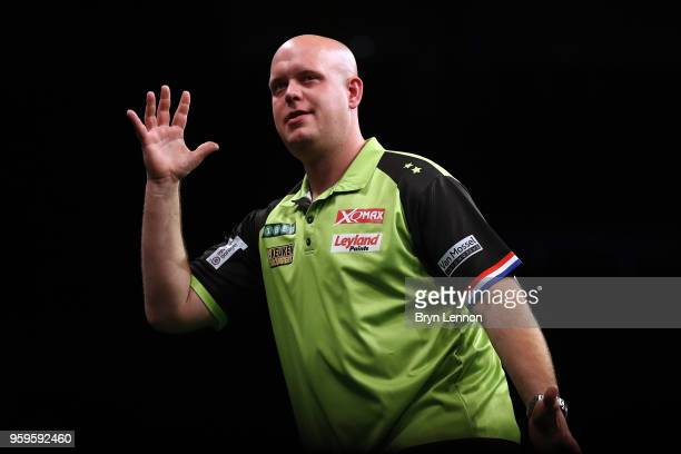 Michael van Gerwen of The Netherlands reacts during his semifinal match against Rob Cross of Great Britain at the Betway Premier League Darts...