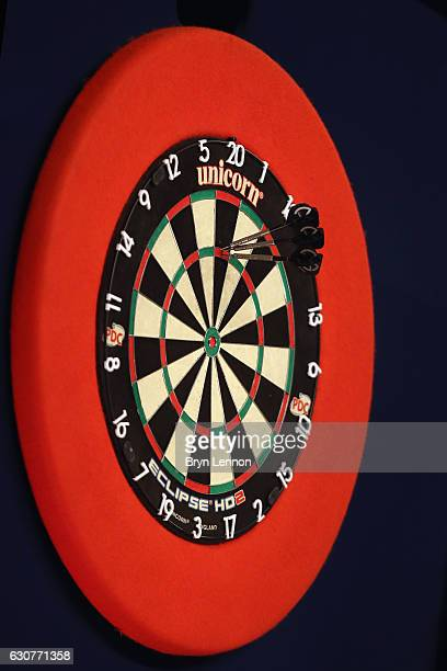 Michael van Gerwen of The Netherlands scores 180 on his way to beating Raymond van Barneveld of The Netherlands in their semifinal on day fourteen of...