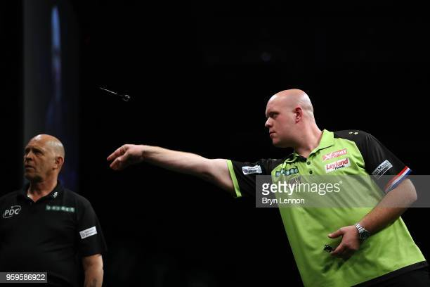Michael van Gerwen of The Netherlands throws against Rob Cross of Great Britain in their semifinal at the Betway Premier League Darts PlayOffs at The...