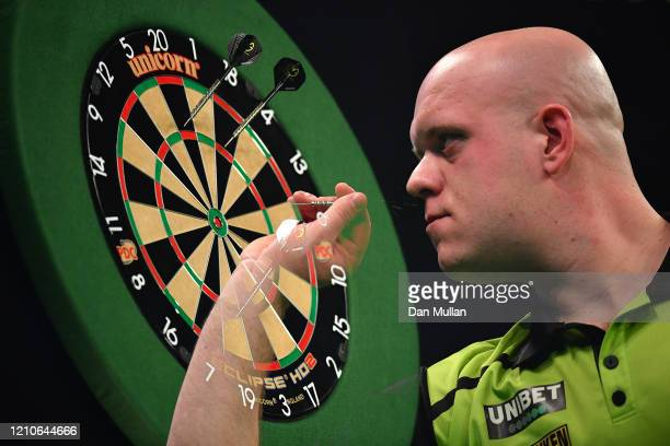 Michael van Gerwen of the Netherlands throws during his match against Michael Smith of England during Night Five of the Premier League Darts at...