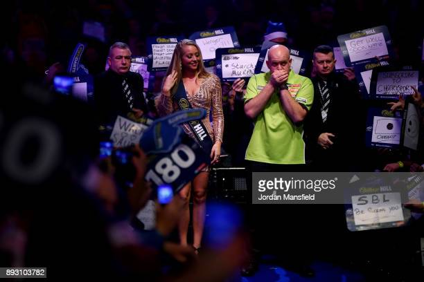 Michael van Gerwen of the Netherlands walks in prior to his first round match against Christian Kist of the Netherlands during day one of the 2018...