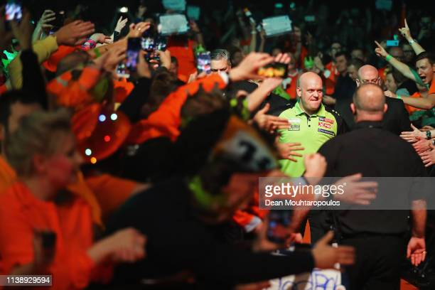 Michael van Gerwen of the Netherlands walks out before he competes against Raymond van Barneveld of the Netherlands during day two of the 2019 Unibet...