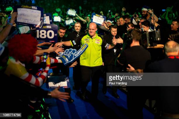 Michael van Gerwen on his walk in before his third round match against Max Hopp during Day 10 of the 2019 William Hill World Darts Championship at...