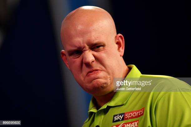Michael Van Gerwen reacts during his Quarter Final Match against Raymond Van Barneveld during the 2018 William Hill PDC World Darts Championships on...