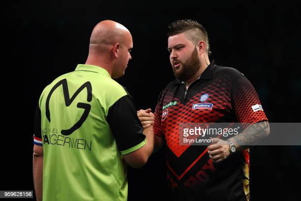 Michael van Gerwin of The Netherlands shakes hands with Michael Smith of Great Britain after beating him in the in the Betway Premier League Darts...