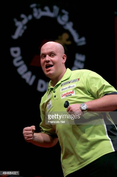 Michael Van Grewen of the Netherlands celebrates winning a point against Adrian Lewis of England during the 2014 Dubai Duty Free Darts Masters...