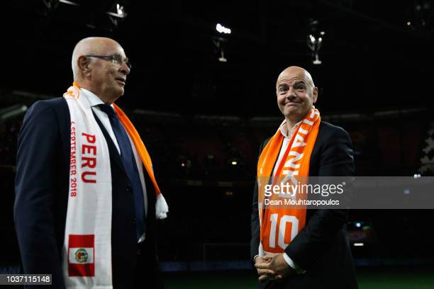 Michael van Praag, President of the KNVB and FIFA president Gianni Infantino wearing a Wesley Sneijder scarf look on after the International Friendly...
