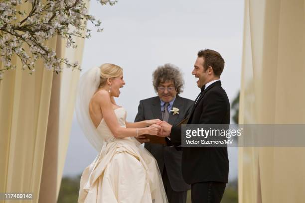 Michael Vartan and Lauren Skaar exchange vows at their wedding ceremony officiated by Michael's stepfather Ian LaFrenais at The Resort at Pelican...