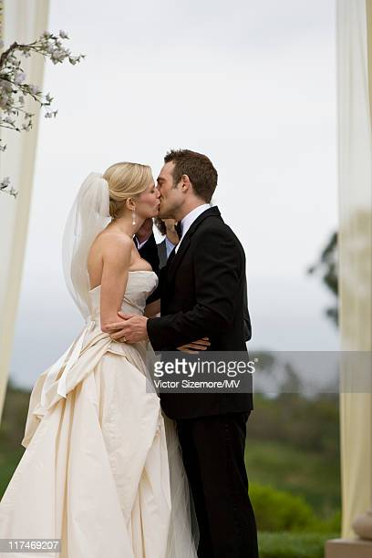 Michael Vartan and Lauren Skaar kiss during their wedding at The Resort at Pelican Hill April 2 2011 in Newport Beach California Lauren is wearing...