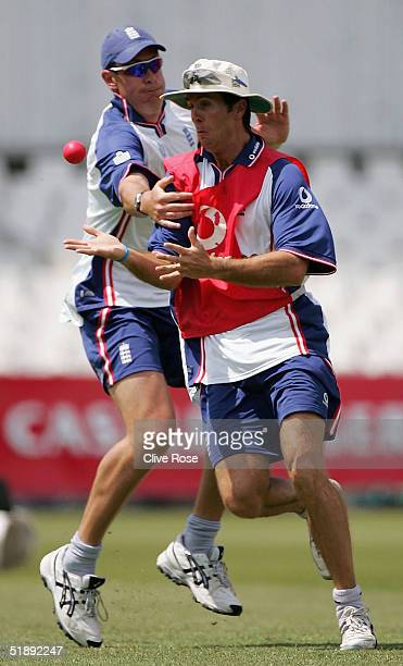 Michael Vaughan and Ashley Giles of England in action during a training session ahead of the second Test Match between South Africa and England in at...