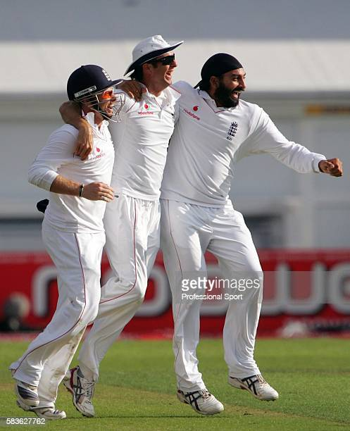 Michael Vaughan of England celebrates with Monty Panesar and Ian Bell after taking a catch during day one of the Second Test match between England...