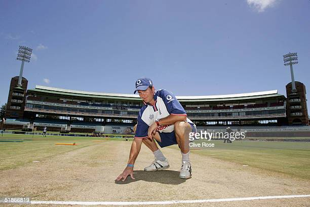 Michael Vaughan of England checks out the wicket condition during a nets session prior to the the 1st Test Match between South Africa and England at...