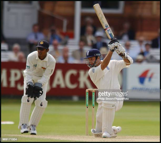 Michael Vaughan of England drives a delivery during his innings of 115 in the 1st Test match between England and Sri Lanka at Lord's Cricket Ground...