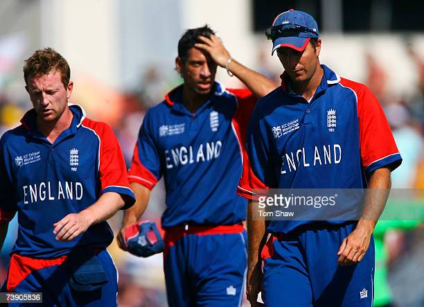 Michael Vaughan of England walks off with Sajid Mahmood and Paul Collingwood after his side were defeated by South Africa during the ICC Cricket...