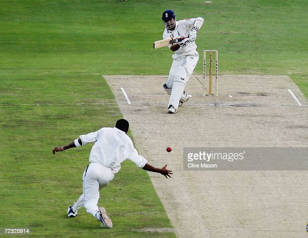 Michael Vaughan of England watches as Makhaya Ntini fields off his own bowling during the second day of the fourth test match between South Africa...
