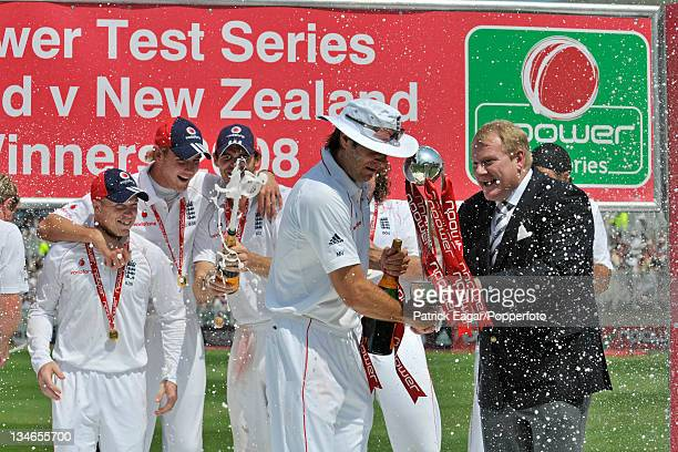 Michael Vaughan receives the npower Trophy from Ian Russell His team mates were premature with the champagne celebrations England v New Zealand 3rd...